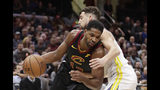 Cleveland Cavaliers' Tristan Thompson (13) drives past Golden State Warriors' Klay Thompson (11) in the first half of an NBA basketball game, Wednesday, Dec. 5, 2018, in Cleveland. (AP Photo/Tony Dejak)
