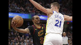 Cleveland Cavaliers' George Hill (3) looks to pass against Golden State Warriors' Jonas Jerebko (21), from Sweden, in the first half of an NBA basketball game, Wednesday, Dec. 5, 2018, in Cleveland. (AP Photo/Tony Dejak)