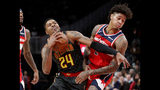 Atlanta Hawks guard Kent Bazemore (24) is fouled by Washington Wizards forward Kelly Oubre Jr. (12) during the first half of an NBA basketball game Wednesday, Dec. 5, 2018, in Atlanta. (AP Photo/John Bazemore)