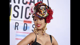FILE - In this Oct. 9, 2018, file photo, Cardi B arrives at the American Music Awards on Tuesday, Oct. 9, 2018, at the Microsoft Theater in Los Angeles. Less than 24 hours after announcing her split from her husband, Cardi B was spotted partying at a night club to kick off Miami's Art Basel. (Photo by Jordan Strauss/Invision/AP, File)