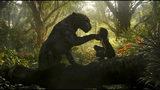 "This image released by Netflix shows Rohan Chand as Mowgli, right, and the character Bagheera, voiced by Christian Bale, in a scene from the film, ""Mowgli: Legend of the Jungle,"" streaming on Netflix on Friday. (Netflix via AP)"