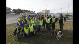 A group of demonstrators wearing their yellow vest pose on an occupied traffic circle, Wednesday, Dec. 5, 2018 outside La Mede oil refinery, near Martigues, southeastern France. Trade unions and farmers pledged Wednesday to join nationwide protests against President Emmanuel Macron, as concessions by the government failed to stem the momentum of the most violent demonstrations France has seen in decades. (AP Photo/Claude Paris)