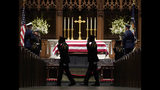 Military members salute as they pay their respects as former President George H.W. Bush lies in repose at St. Martin's Episcopal Church Wednesday, Dec. 5, 2018, in Houston. (AP Photo/David J. Phillip, Pool)