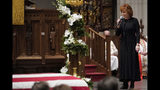 """Reba McEntire sings """"The Lord's Prayer"""" during a funeral service for former President George H.W. Bush at St. Martin's Episcopal Church Thursday, Dec. 6, 2018, in Houston. (AP Photo/David J. Phillip, Pool)"""