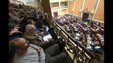 People look on as the Utah Legislature went into session Monday, Dec. 3, 2018, in Salt Lake City. Utah lawmakers are meeting to consider changes to a voter-approved ballot initiative legalizing medical marijuana in a move that has generated backlash among supporters of the pot measure. (AP Photo/Rick Bowmer)