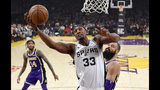 San Antonio Spurs forward Dante Cunningham, center, shoots as Los Angeles Lakers forward Brandon Ingram, left, and center Tyson Chandler defend during the first half of an NBA basketball game Wednesday, Dec. 5, 2018, in Los Angeles. (AP Photo/Mark J. Terrill)