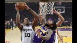 San Antonio Spurs guard DeMar DeRozan, left, shoots as Los Angeles Lakers forward Brandon Ingram during the first half of an NBA basketball game Wednesday, Dec. 5, 2018, in Los Angeles. (AP Photo/Mark J. Terrill)