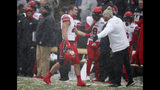 FILE - In this Saturday, Nov. 17, 2018, file photo, Utah linebacker Chase Hansen, left, heads off the field after he was ejected for targeting while sacking Colorado quarterback Steven Montez in the first half of an NCAA college football game in Boulder, Colo. The NCAA says the number of enforced targeting penalties in the Football Bowl Subdivision this regular season was the same as in 2017. (AP Photo/David Zalubowski, File)