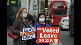 Demonstrators protest for Brexit outside the Houses of Parliament in London Thursday Dec. 6, 2018. Britain's Prime Minister Theresa May's effort to win support for her Brexit agreement comes amid reports in British newspapers Thursday, predicting that Parliament could reject the deal by more than 100 votes. (AP Photo/Frank Augstein)