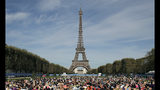"""FILE - In this Saturday, Sept. 8, 2018 file photo, participants perform yoga in front of the Eiffel Tower as part of the sport event """"La Parisienne"""", in Paris. The Eiffel Tower announces it will be closed on Saturday, Dec. 8 due to the protests called in the French capital by the yellow vest movement. Tickets bought online will be refunded, the company operating the Paris monument said on Twitter. (AP Photo/Christophe Ena, file)"""