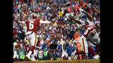 New York Giants outside linebacker Kareem Martin, right, tips a pass by Washington Redskins quarterback Mark Sanchez (6) enabling New York Giants free safety Curtis Riley to intercept the pass and return it for a touchdown, during the first half of an NFL football game Sunday, Dec. 9, 2018, in Landover, Md. (AP Photo/Patrick Semansky)