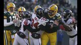 Players scuffle during the first half of an NFL football game between the Green Bay Packers and the Atlanta Falcons Sunday, Dec. 9, 2018, in Green Bay, Wis. (AP Photo/Mike Roemer)