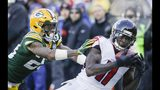 Atlanta Falcons' Julio Jones catches a pass in front of Green Bay Packers' Jaire Alexander during the first half of an NFL football game Sunday, Dec. 9, 2018, in Green Bay, Wis. (AP Photo/Jeffrey Phelps)