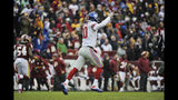 New York Giants quarterback Eli Manning (10) celebrates the 78-yard touchdown run by running back Saquon Barkley during the first half of an NFL football game against the Washington Redskins, Sunday, Dec. 9, 2018, in Landover, Md. (AP Photo/Mark Tenally)