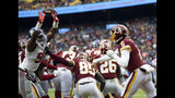 New York Giants outside linebacker Kareem Martin, left, tips a pass by Washington Redskins quarterback Mark Sanchez (6) enabling New York Giants free safety Curtis Riley to intercept the pass and return it for a touchdown, during the first half of an NFL football game Sunday, Dec. 9, 2018, in Landover, Md. (AP Photo/Nick Wass)