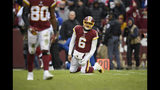 Washington Redskins quarterback Mark Sanchez (6) reacts after throwing an interception during the first half of an NFL football game against the New York Giants, Sunday, Dec. 9, 2018, in Landover, Md. (AP Photo/Nick Wass)