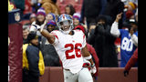 New York Giants running back Saquon Barkley (26) celebrates his 78-yard touchdown during the first half of an NFL football game against the Washington Redskins, Sunday, Dec. 9, 2018, in Landover, Md. (AP Photo/Patrick Semansky)