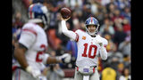 New York Giants quarterback Eli Manning (10) throws to New York Giants running back Saquon Barkley, left, during the first half of an NFL football game against the Washington Redskins, Sunday, Dec. 9, 2018, in Landover, Md. (AP Photo/Nick Wass)