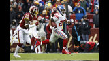 New York Giants running back Saquon Barkley (26) runs away from Washington Redskins strong safety Ha Ha Clinton-Dix (20) for a 78-yard touchdown during the first half of an NFL football game Sunday, Dec. 9, 2018, in Landover, Md. (AP Photo/Patrick Semansky)