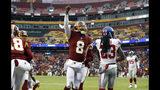 Washington Redskins quarterback Josh Johnson (8) celebrates his touchdown during the second half of an NFL football game against the New York Giants, Sunday, Dec. 9, 2018, in Landover, Md. (AP Photo/Patrick Semansky)