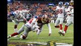 Washington Redskins quarterback Josh Johnson (8) scores a touchdown past New York Giants defensive back Grant Haley (34) during the second half of an NFL football game Sunday, Dec. 9, 2018, in Landover, Md. (AP Photo/Patrick Semansky)