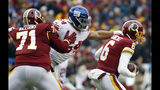 Washington Redskins offensive tackle Trent Williams (71) cannot stop a sack by New York Giants outside linebacker Olivier Vernon (54) against Redskins quarterback Mark Sanchez (6) during the first half of an NFL football game Sunday, Dec. 9, 2018, in Landover, Md. (AP Photo/Patrick Semansky)