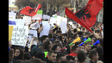 Albania University students protest outside the Education Ministry in Tirana, Tuesday, Dec. 11, 2018. Student demands include cutting tuition fees in half, doubling the budget for education and a greater student presence on decision-making boards. (AP Photo/ Hektor Pustina)