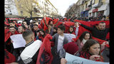 University and school students wave Albanian flags as they protest in Tirana, Tuesday, Dec. 11, 2018. Student demands include cutting tuition fees in half, doubling the budget for education and a greater student presence on decision-making boards. (AP Photo/ Hektor Pustina)