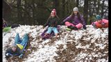 From left; Katie Pilon, 10, twins Cecilia Caldwell and Annie Caldwell, both 10, and Camilla Hart, 10, slide down a Latta Park hill that has seen it's share of sleds in Charlotte, on Monday, Dec. 10, 2018. While the mountains got a blanketing of snow on Sunday Charlotte got sleet and freezing rain but Monday, Dec. 10, 2018 was a new day with a different result, it snowed. (John D. Simmons/The Charlotte Observer via AP)