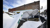 The awning covering the outside seating area at the Quaker Steak and Lube restruarant on State Street in Bristol, Virginia collapsed under the weight of the heavy snowfall. Seen Monday, Dec. 10, 2018. (AP Photo, David Crigger/The Bristol Herald-Courier via AP)