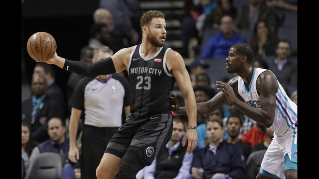 5058911c9a2 Detroit Pistons  Blake Griffin (23) drives against Charlotte Hornets   Marvin Williams during the first half of an NBA basketball game in  Charlotte
