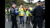 """French police officers evacuate demonstrators wearing yellow vests near the French Spanish border in Biriatou during a protest Saturday, Dec. 15, 2018 in Biriatou, southwestern France. Police are deployed in large numbers Saturday for the fifth straight weekend of demonstrations by the """"yellow vest"""" protesters, with authorities repeating calls for calm after protests on previous weekends turned violent. (AP Photo/Bob Edme)"""