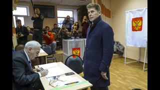 Kremlin candidate wins in repeated vote in Russia