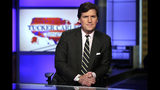 "FILE - In this March 2, 2017, file photo, Tucker Carlson, host of ""Tucker Carlson Tonight,"" poses for photos in a Fox News Channel studio in New York. Some advertisers say they are leaving conservative host Carlson's show following his remarks referring to immigrants as ""the world's poor."" It's the latest example of sponsors leaving a Fox News Channel show after controversy, but experts say the flap is likely to blow over. So far, the biggest advertisers are sticking with him and his show, ""Tucker Carlson Tonight."" (AP Photo/Richard Drew, File)"