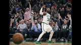 Boston Celtics guard Marcus Smart (36), and fans, celebrate after hitting a 3-point shot to end the second quarter of a basketball game against the Phoenix Suns in Boston, Wednesday, Dec. 19, 2018. (AP Photo/Charles Krupa)