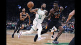 Boston Celtics guard Kyrie Irving (11) passes the ball as he drives against Phoenix Suns center Deandre Ayton (22) during the second quarter of a basketball game in Boston, Wednesday, Dec. 19, 2018. (AP Photo/Charles Krupa)