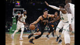 Phoenix Suns guard Devin Booker (1) drives to the basket against the Boston Celtics during the second half of a basketball game in Boston, Wednesday, Dec. 19, 2018. The Suns defeated the Celtics 111-103. (AP Photo/Charles Krupa)