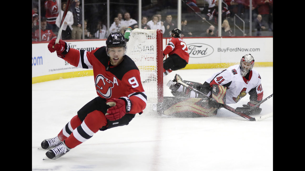 Hall has 2 goals, 2 assists as slumping Devils beat Senators
