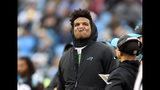 Carolina Panthers' Cam Newton watches the action from thew sidelines during the second half of an NFL football game against the Atlanta Falcons in Charlotte, N.C., Sunday, Dec. 23, 2018. (AP Photo/Mike McCarn)