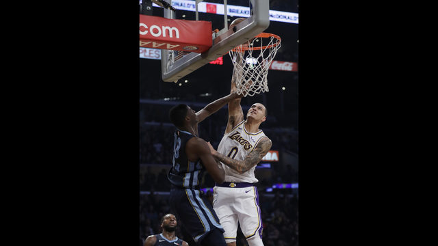 ee503987d Los Angeles Lakers  Kyle Kuzma (0) goes up for a dunk as Memphis Grizzlies   Jaren Jackson Jr. defends during the first half of an NBA basketball game  Sunday ...
