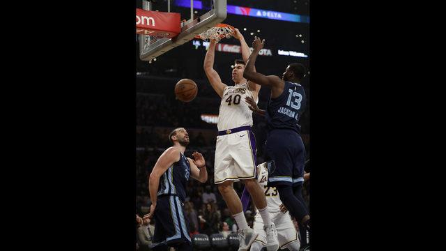 1d29ff467 Los Angeles Lakers  Ivica Zubac (40) dunks between Memphis Grizzlies  Marc  Gasol