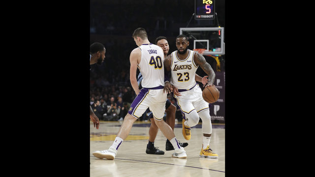 a3551a415 Los Angeles Lakers  LeBron James (23) dribbles around a screen set up by  teammate Ivica Zubac (40) on Memphis Grizzlies  Kyle Anderson