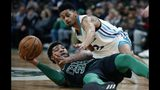 Boston Celtics' Marcus Smart (36) and Charlotte Hornets' Jeremy Lamb (3) battle for the ball during the second half of an NBA basketball game in Boston, Sunday, Dec. 23, 2018. (AP Photo/Michael Dwyer)