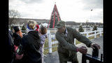 A National Park Service employee closes the gate to visitors at the National Christmas Tree on the Ellipse near the White House, Monday, Dec. 24, 2018, in Washington. The area was reopened after electrical repairs were made. These repairs were delayed because of the partial government shutdown. Both sides in the long-running fight over funding President Donald Trump's U.S.-Mexico border wall appear to have moved toward each other, but a shutdown of one-fourth of the federal government entered Christmas without a clear resolution in sight. (AP Photo/Andrew Harnik)