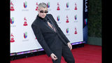 FILE - In this Nov. 15, 2018 file photo, Bad Bunny arrives at the Latin Grammy Awards at the MGM Grand Garden Arena in Las Vegas. (Photo by Eric Jamison/Invision/AP, File)