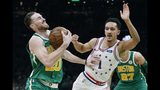 Boston Celtics' Gordon Hayward (20) is defended by Philadelphia 76ers' Landry Shamet (1) during the first half of an NBA basketball game in Boston, Tuesday, Dec. 25, 2018. (AP Photo/Michael Dwyer)