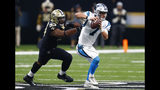Carolina Panthers quarterback Kyle Allen (7) scrambles under pressure from New Orleans Saints defensive tackle David Onyemata (93) in the first half of an NFL football game in New Orleans, Sunday, Dec. 30, 2018. (AP Photo/Butch Dill)