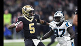 New Orleans Saints quarterback Teddy Bridgewater (5) drops back to pass under pressure from Carolina Panthers defensive end Mario Addison (97) in the first half of an NFL football game in New Orleans, Sunday, Dec. 30, 2018. (AP Photo/Bill Feig)