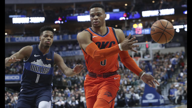 Oklahoma City Thunder guard Russell Westbrook (0) passes the ball in front  of Dallas Mavericks guard Dennis Smith Jr. (1) during the first half of an  NBA ... ff52f99c2
