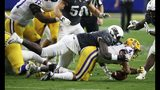 UCF defensive lineman Brendon Hayes, left, tackles LSU running back Nick Brossette (4) during the first half of a Fiesta Bowl NCAA college football game Tuesday, Jan. 1, 2019, in Glendale, Ariz. (AP Photo/Ross D. Franklin)